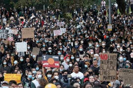 Thousands of protesters gather in Sydney, June 6, 2020, to support the movement of U.S. protests over the death of George Floyd.