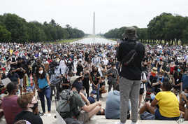Demonstrators protest Saturday, June 6, 2020, at the Lincoln Memorial in Washington, over the death of George Floyd, a black man who was in police custody in Minneapolis. Floyd died after being restrained by Minneapolis police officers.