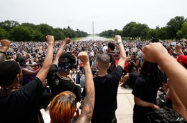 Demonstrators protest June 6, 2020, at the Lincoln Memorial in Washington, over the death of George Floyd.