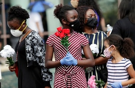 Mourners arrive at a public visitation for George Floyd at the Fountain of Praise Church on June 8, 2020 in Houston.