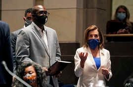 Philonise Floyd, a brother of George Floyd, and House Speaker Nancy Pelosi of Calif., arrive for a House Judiciary Committee…