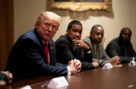 President Donald Trump speaks during a roundtable discussion with African-American supporters in the Cabinet Room of the White…