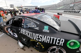 The car for driver Bubba Wallace has a Black Lives Matter logo as it is prepared for a NASCAR Cup Series auto race Wednesday,…