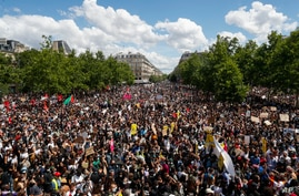 Thousands of people demonstrate against police brutality and racism in Paris, France, June 13, 2020, prior to a march organized by supporters of Adama Traore, who died in police custody in 2016 in circumstances that remain unclear.