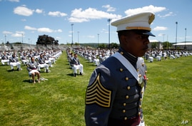 United States Military Academy graduating cadets queue to present themselves on stage as their names are called