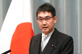 FILE - Japan's Justice Minister Katsuyuki Kawai speaks during a press conference at the prime minister's official residence in Tokyo.