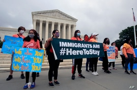 Deferred Action for Childhood Arrivals (DACA) students celebrate in front of the Supreme Court