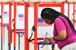 A voter fills out her ballot during the Kentucky Primary at the Kentucky Exposition Center in Louisville, Ky., Tuesday, June 23…