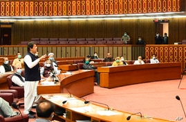 """In this photo released by the Press Information Department, Pakistani Prime Minister addresses the Parliament in Islamabad, Pakistan, June 25, 2020. Khan accused the United States on Thursday of having """"martyred"""" al-Qaida leader Osama bin Laden."""