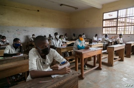 FILE - Students wearing face masks to protect against the coronavirus are seen in class at Lycee General Leclerc School in Yaounde, Cameroon, June 1, 2020.