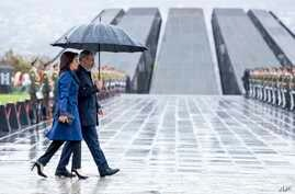 Armenian Prime Minister Nikol Pashinian and his wife Anna Akobian arrive at the monument to the victims of mass killings by Ottoman Turks, to commemorate the 105th anniversary of the massacre in Yerevan, April 24, 2020.
