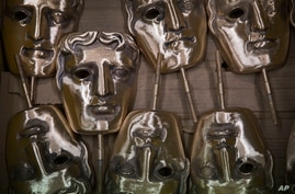 Bronze alloy masks lie in a foundry in West Drayton, Middlesex, Jan. 31, 2020, ahead of the British Acadamy Film and Television awards ceremony in February.