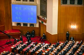 A video screen shows the results of the vote on a piece of national security legislation concerning Hong Kong during the closing session of China's National People's Congress (NPC) in Beijing, China, May 28, 2020.