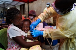 FILE- A child is vaccinated against Ebola in Beni, DRC, July 13, 2019.