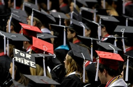 FILE - Students participate in graduation ceremonies at the University of Alabama, in Tuscaloosa, Alabama, Aug. 6, 2011.