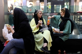 People have their lunch in a shopping center at the Tehran's Grand Bazaar in Iran, June 10, 2020.