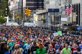 FILE - Runners take part in the New York City Marathon, Nov. 3, 2019. The annual event which this year had been scheduled for Nov. 1, 2020, has been cancelled because of the coronavirus pandemic.