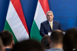 FILE - Hungarian Prime Minister Viktor Orban adresses the media during a press conference in Budapest, Hungary, Jan. 9, 2020.