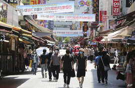 People walk on a shopping district in Seoul, South Korea, June 11, 2020.
