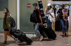 Passengers arrive at Barcelona Airport, Spain, June 30, 2020.