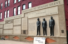 A sign at the Clayton Jackson McGhie Memorial in Duluth, Minnesota, reads 'Justice for George Floyd,' June 9, 2020.