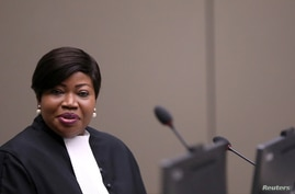 FILE - Fatou Bensouda, the chief prosecutor of the International Criminal Court, is seen in a courtroom of the ICC in The Hague, Netherlands, July 8, 2019.