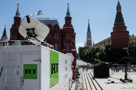 FILE - Vehicles of Russian state-controlled broadcaster RT are seen near Red Square in central Moscow, Russia, June 15, 2018.