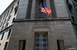 FILE - The U.S. Department of Justice headquarters building is seen in Washington, July 13, 2018.