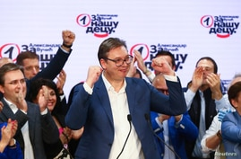 Serbian President Aleksandar Vucic gestures at Serbian Progressive Party (SNS) headquarters during a national election, the first in Europe since the outbreak of the coronavirus pandemic, in Belgrade, Serbia, June 21, 2020.