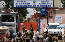 Afghan security forces standing guard outside the Dasht-e-Barchi Hospital which came under attack in Kabul, Afghanistan, May 12, 2020.