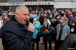 Belarusian opposition figure Nikolai Statkevich speaks during a rally in support of opposition politicians who collect signatures for nomination as candidates in the upcoming presidential election, amid the coronavirus  outbreak in Minsk, May 24, 2020.