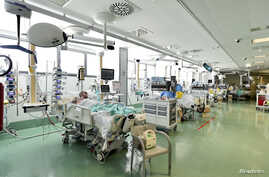 Patients suffering from the coronavirus disease (COVID-19) are seen in the intensive care unit at the Papa Giovanni XXIII hospital in Bergamo, Italy, May 12, 2020.