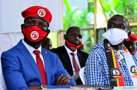 Ugandan musician turned politician, Robert Kyagulanyi, also known as Bobi Wine and four time Presidential candidate Kizza Besigye attend a joint news conference in Wakiso district, in Kampala, June 15, 2020.