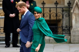 (FILES) In this file photo taken on March 09, 2020 Britain's Prince Harry, Duke of Sussex, (L) and Meghan, Duchess of Sussex…