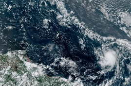 This RAMMB/NOAA satellite image obtained on July 22, 2020, shows Tropical Storm Gonzalo (lower R) at 17:10:25 UTC. - Gonzalo,…