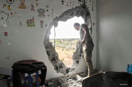 A hole was blown into the children's room of Wasef Gelani's home during the war, in Tripoli, Libya, June 6, 2020. (Photo courtesy of Wasef Gelani)