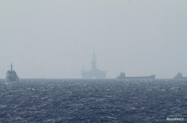 An oil rig (C) which China calls Haiyang Shiyou 981, and Vietnam refers to as Hai Duong 981, is seen in the South China Sea,…