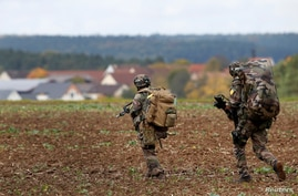 Soldiers are pictured during an exercise of the U.S. Army's Global Swift Response 17 Media Day near Hohenfels, Germany, October…