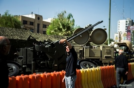 A man takes a selfie in front of an anti-aircraft weapon on display at Baharestan Square in Tehran, Iran September 27, 2017…