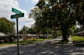 A sign marks Arcola Street in Precinct 25A, where the vote was split 358/358 between Donald Trump and Hillary Clinton in 2016,…