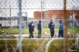 Inmates exercise in the yard at the Marion Correctional Institution where there have been positive cases of the coronavirus…