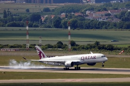 FILE - A Qatar Airways Airbus A350 lands at Paris Charles de Gaulle airport in Roissy-en-France during the outbreak of the coronavirus disease (COVID-19) in France, May 25, 2020. Picture taken May 25, 2020.