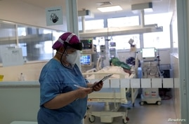 Nurse Eva Fiori updates a medical record of a patient suffering from the coronavirus disease (COVID-19) at the Intensive Care…
