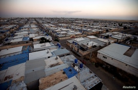 General view of Qushtapa refugee camp, in Erbil, Iraq, June 17, 2020. Picture taken June 17, 2020. REUTERS/Azad Lashkari    …