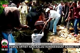 Ethiopian musician Haacaaluu Hundeessaa is buried in Ambo, Ethiopia, July 2, 2020, in this still image from a video.