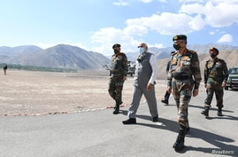 India's Prime Minister Narendra Modi visits Himalayan region of Ladakh, July 3, 2020. India's Press Information Bureau/Handout…