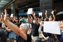 Supporters raise white paper to avoid slogans banned under the national security law as they support arrested anti-law…