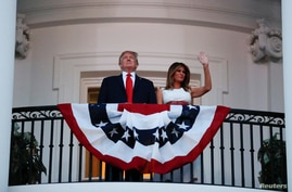 U.S. President Donald Trump and first lady Melania Trump watch the Washington, D.C. fireworks display from the Truman Balcony…