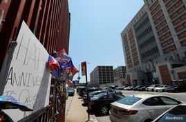 Messages to a prisoner are seen on a wall across the street from The Metropolitan Detention Center (MDC) where Ghislaine…