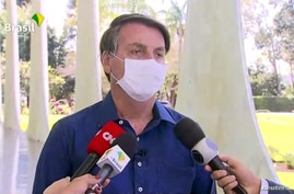 Brazil's President Jair Bolsonaro confirms positive coronavirus diagnosis as he speaks to the media in Brasilia, Brazil July 7,…